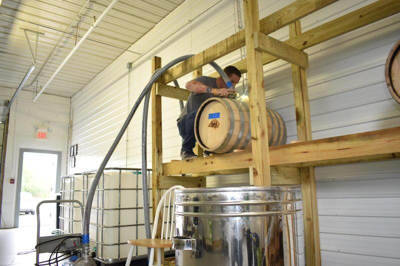 Steve Gagner fills one of the first barrels of bourbon from Danger Close Craft Distilling.