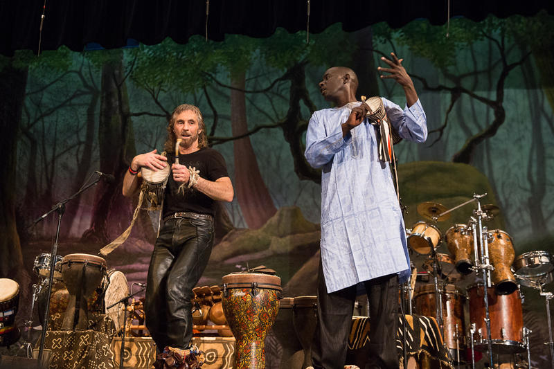 Massamba Diop (right) and Tony Vacca (left) perform during an assembly at Roger Ludlowe Middle School in Fairfield, Connecticut.