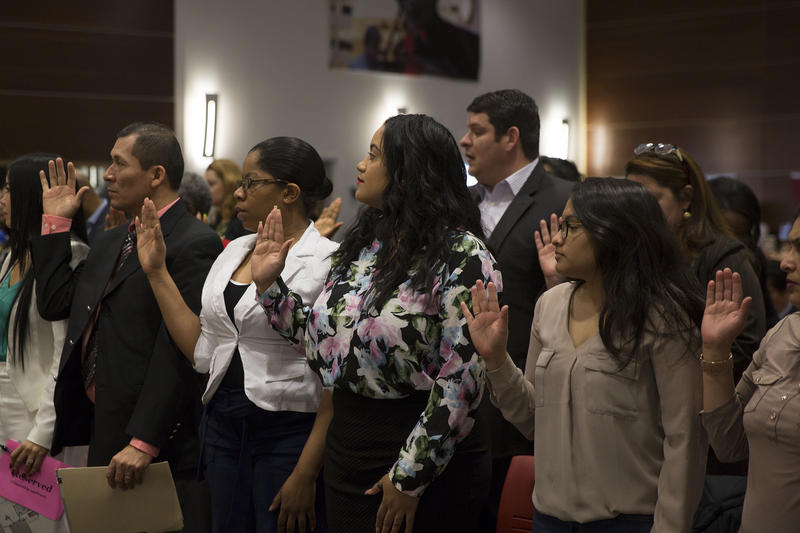 Taking the Oath of Allegiance during Thursday's naturalization ceremony at Hartford Public Library.