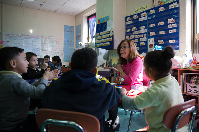Nilda Medina, a first-grade bilingual teacher at Sanchez Elementary School in Hartford, teaches students about the seasons. About half of the students in the class are evacuees from Puerto Rico.