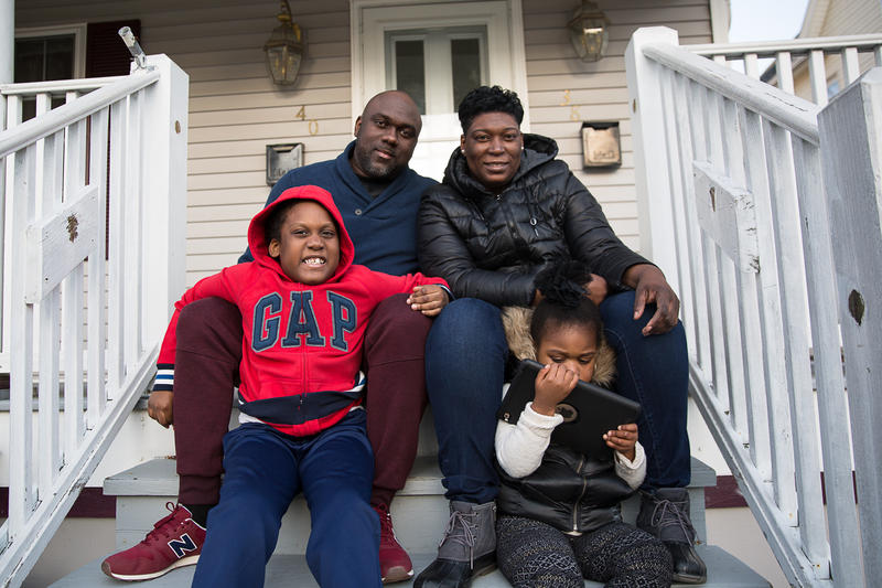 Lisa Wilson (top right) with her family in Hartford, Connecticut. Her son was diagnosed with autism spectrum disorder.