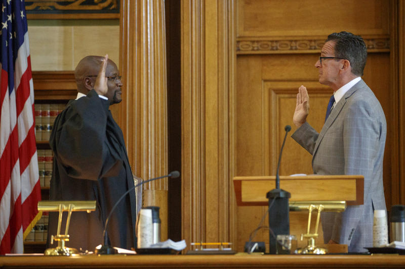 Richard Robinson is sworn in by Gov. Dannel Malloy as the first African-American chief justice of the Connecticut Supreme Court.
