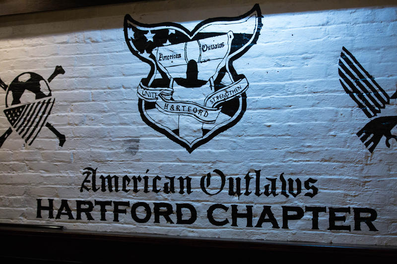 The group's logo is painted on a wall in the basement of the Hartford chapter's hangout.