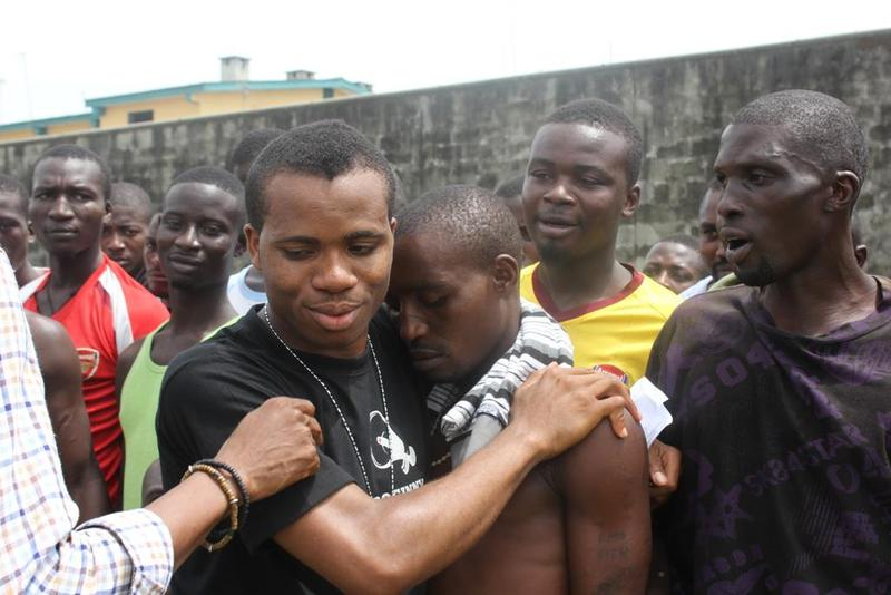 Lamboginny (center) comforts young prisoners at Nigeria's Ikoyi Prison