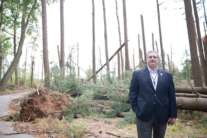 "Tom Tyler, director of Connecticut State Parks, inside Sleeping Giant's picnic area. This and other parts of the park were destroyed following severe storms. Tyler said he's ""optimistic"" parts will re-open before the fall."