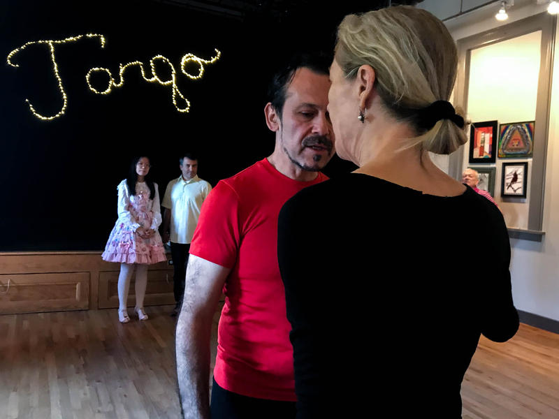 Instructors Gem Duras (left) and Dale Ellison (right) demonstrate Tango for beginner students at a boot camp in Milford during the Connecticut Tango Festival.
