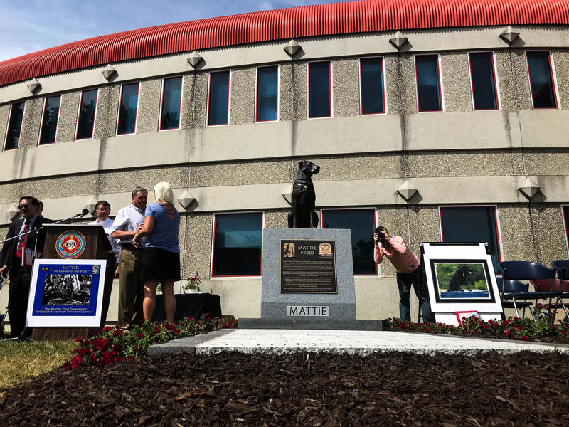 A statue of a black lab in the likeness of Mattie, a K-9 that served with the Connecticut State Police for six years, sits a top a memorial built outside of the Connecticut Fire Academy in Windsor Locks.