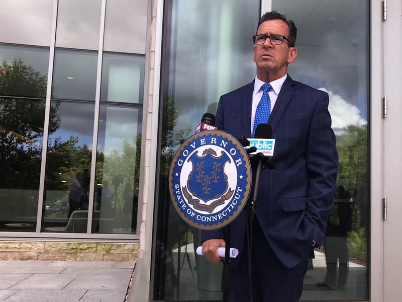 Gov. Dannel Malloy defended his position on tolls in an off-topic news conference outside of The Jackson Laboratory in Farmington on July 24.