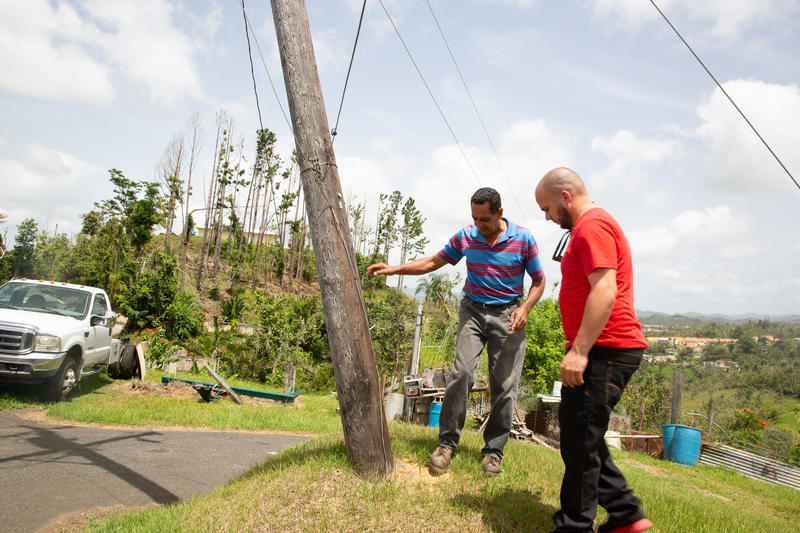 Jose Ortiz (left) and Jovanny Perez (right) helped lead a neighborhood effort after Maria to bring electricity back.