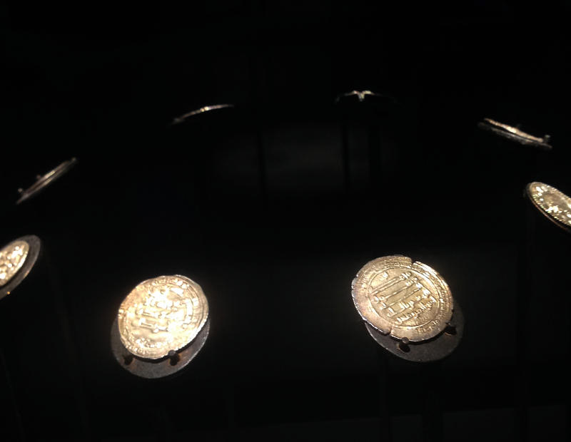Coins from the Arab Caliphate found in a Viking burial site on display at Mystic Seaport Museum.