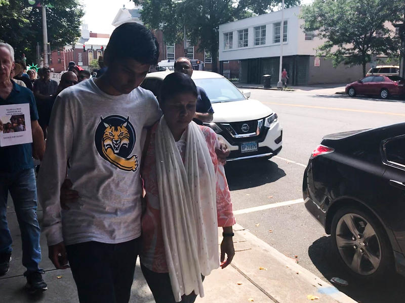 Samir Mahmud supports his mother Salma Sikander as she leaves her final immigration check-in before a deportation scheduled for Thursday, August 23.