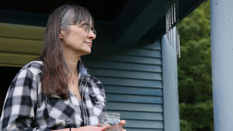 Hilary Mullins stands outside her Vermont home after she detailed the abuse she suffered as a teenager by two teachers from the Connecticut boarding school.