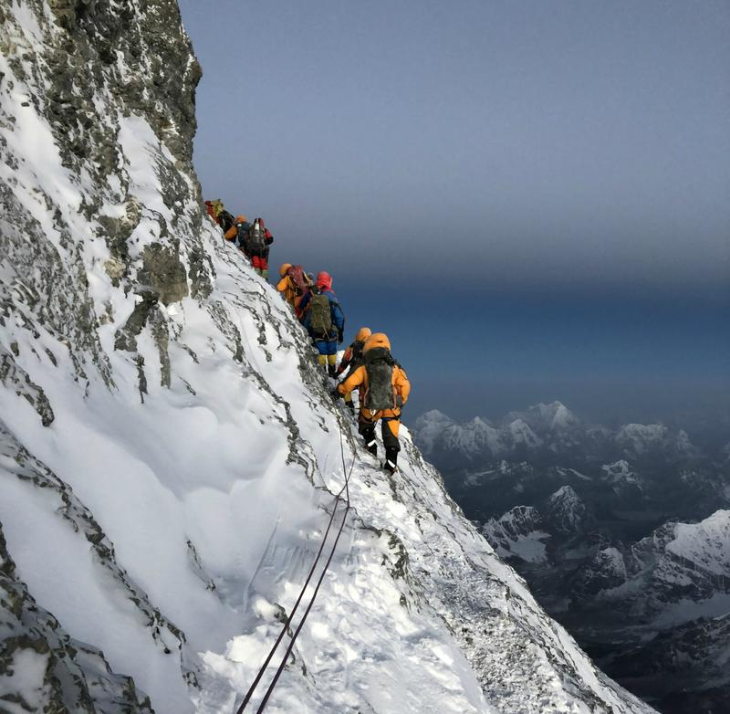 Climbers make their way up Mt. Everest.