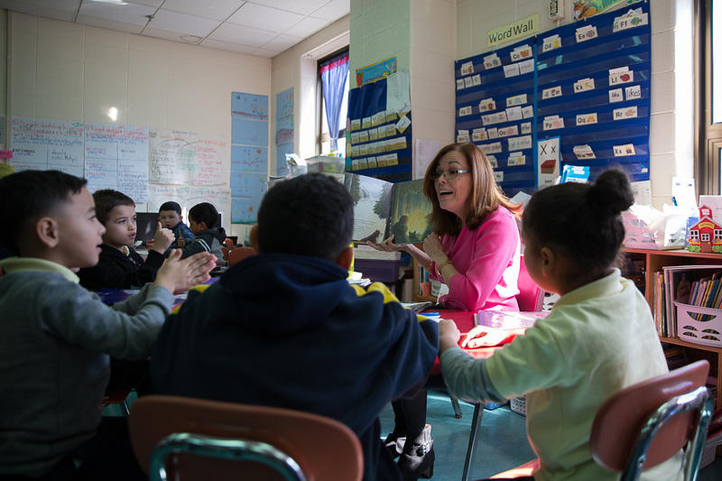 Nilda Medina, a first-grade bilingual at Sanchez Elementary School in Hartford, teaches students about the seasons. About half of the kids in the class are evacuees from Puerto Rico.
