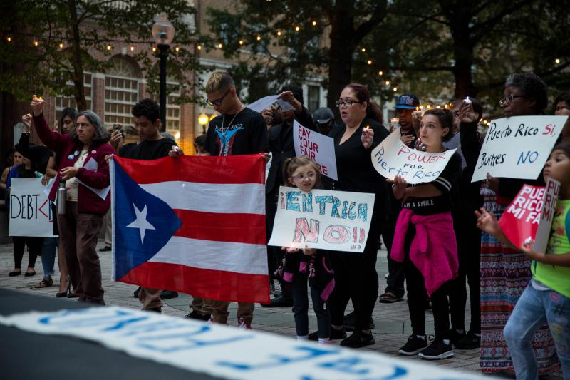 The vigil took place on McLevy Green in Bridgeport and was held in memory of those that died in the aftermath of Hurricane Maria -- one year to the day that the storm hit Puerto Rico.