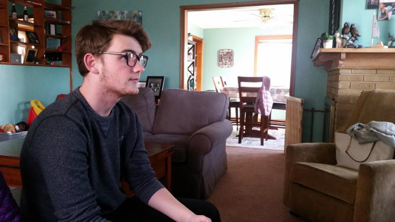 Owen Lynch plays a video game at his former home in Norwalk.
