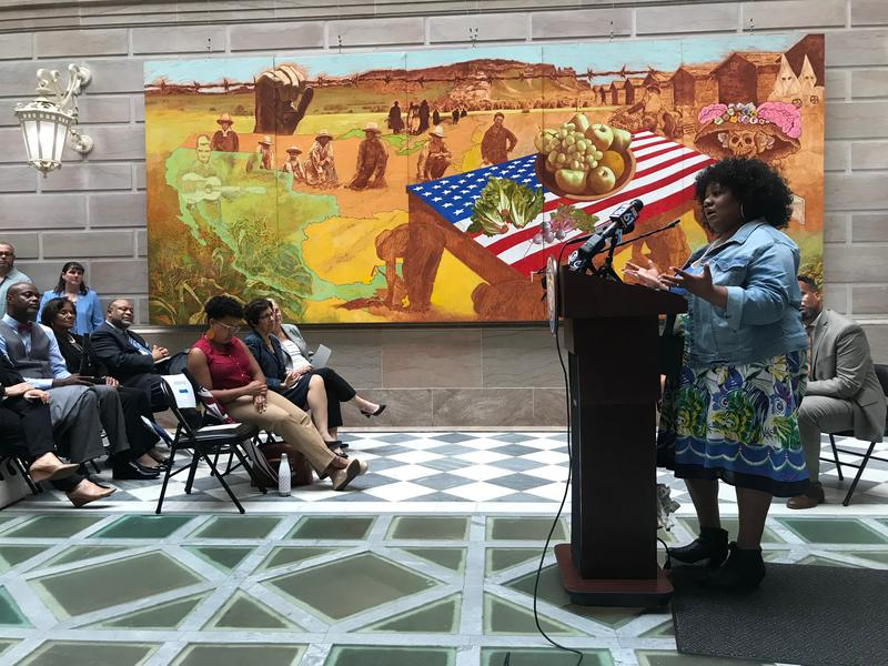 Stephanie Harris-Adkins addresses the crowd in City Hall at the Re-Entry Welcome Center opening ceremony.