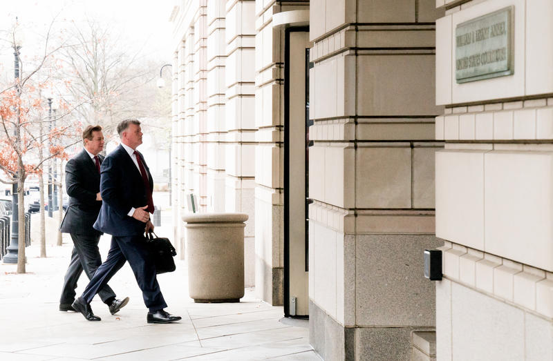 Paul Manafort, left, walks into court with his lawyer Kevin Downing on April 4, 2018.