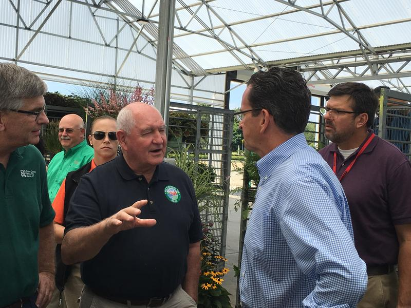 Agriculture Secretary Sonny Perdue speaks with Governor Dannel Malloy on a previous visit to Connecticut in 2017
