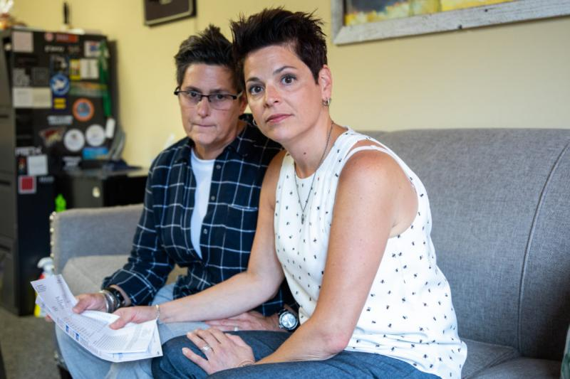Lauren Goldstein (left) and her wife, Joan Goldstein, are fighting their insurance company's refusal to pay a $3,094 ER bill.