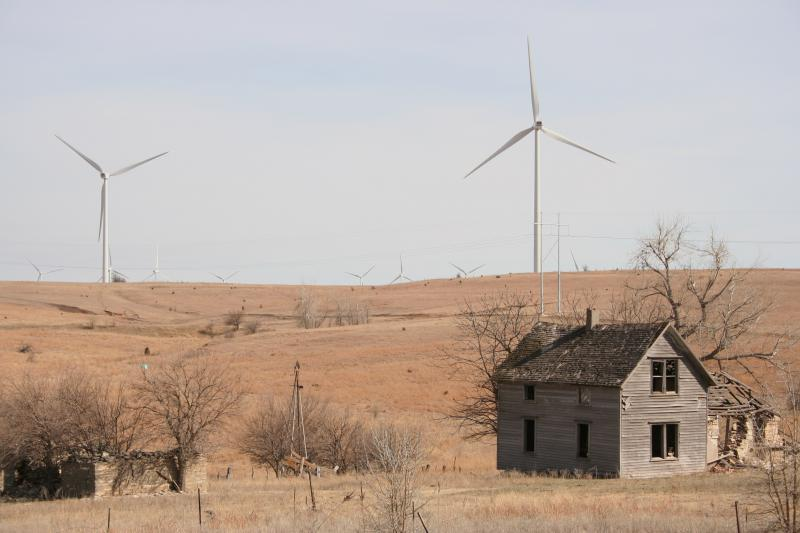 Abandoned farmhouse with turbines in the background. Meridian Way Wind Farm, Cloud County, Kansas.