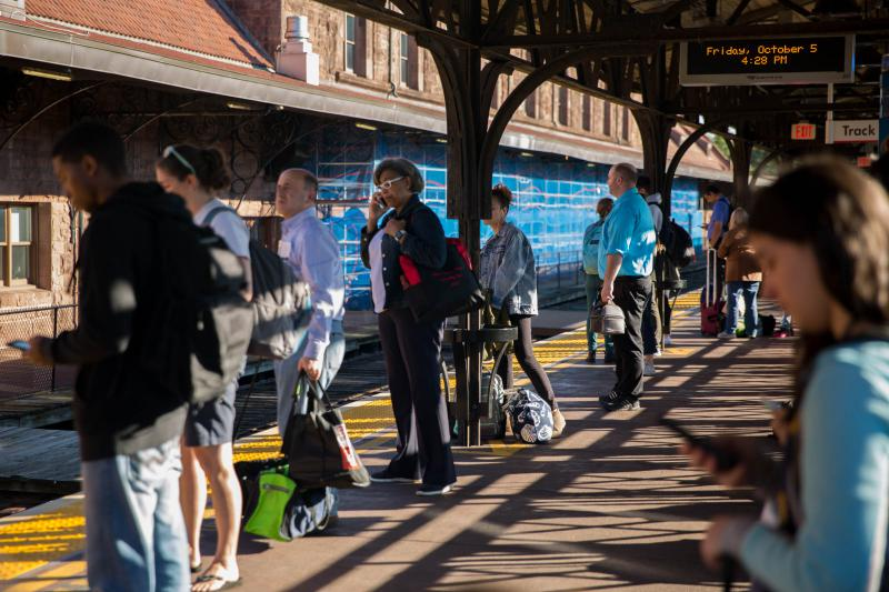 Riders prepare to get on the 4:32 p.m. Amtrak train at Hartford's Union Station on October 5, 2018.