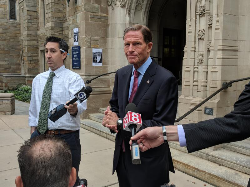 Senator Richard Blumenthal speaks to reporters outside Yale Law School on September 24, 2018.
