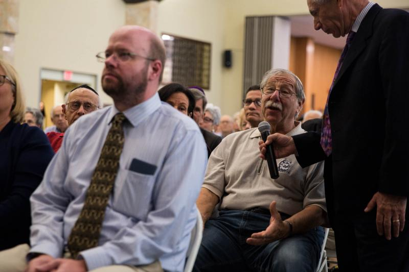 Windsor resident Joel Kent questions Oz Griebel during a gubernatorial forum hosted by The Jewish Federation of Greater Hartford on October 7, 2018.