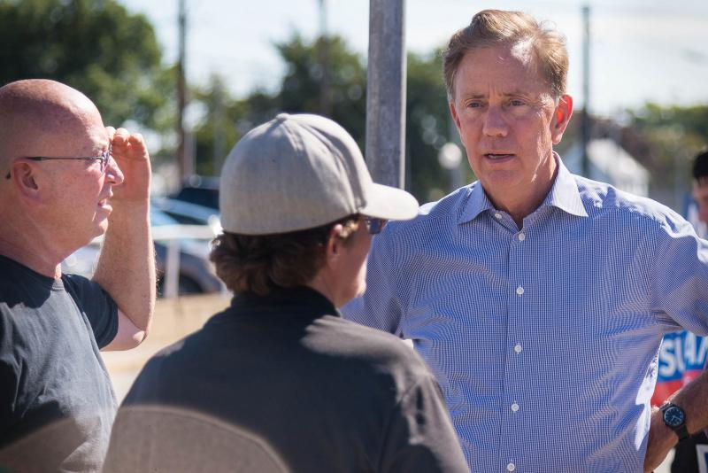 Democratic candidate Ned Lamont talks to voters outside of Electric Boat in Groton, Conn.