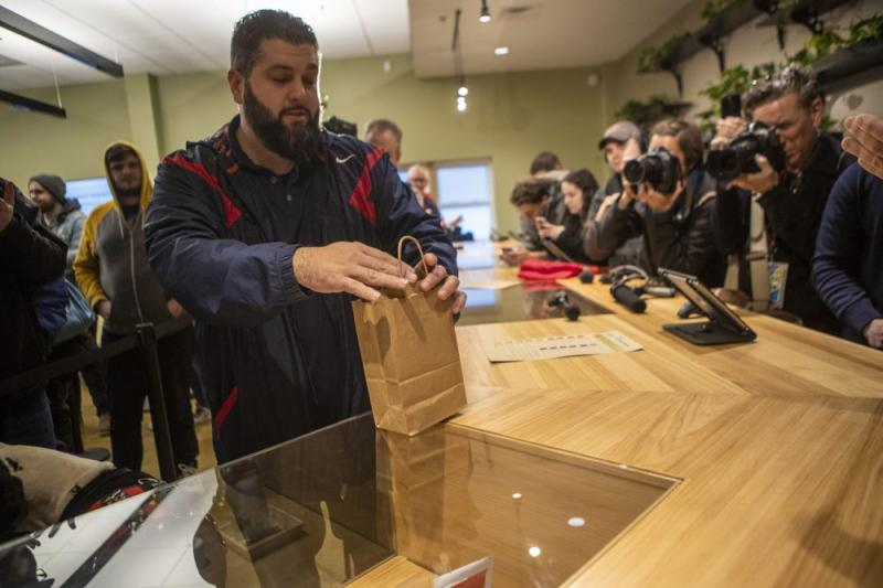 Veteran Steven Mandile make the first purchase of recreational marijuana in Massachusetts at Cultivate in Leicester.