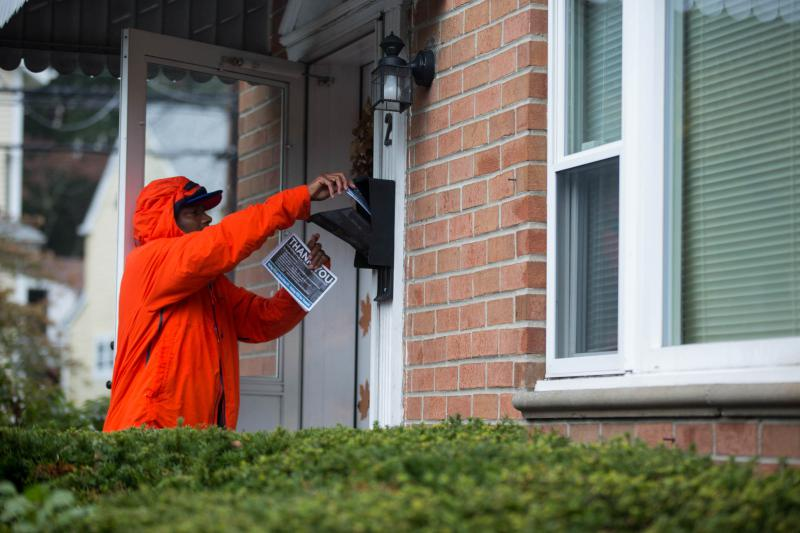 A member the Stamford branch of the Amalgamated Transit Union leaves a pamphlet behind at a residence in Glenbrook section of town as part of an effort by ATU workers on October 28, 2018 to spread the word about the lockbox ballot question.