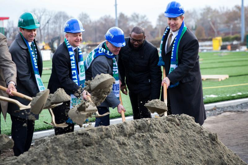 Hartford Athletic owner Bruce Mandell (second from left) is joined by Hartford Mayor Luke Bronin (far left) in ceremonial groundbreaking at Dillon Stadium. The team is hoping to play soccer at the stadium next May.