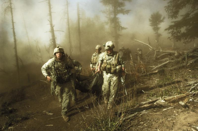 US troops carry the body of Staff Sergeant Larry Rougle, who was killed when Taliban  insurgents ambushed their squad in the Kore ngal Valley, Afghanistan, October 2007.
