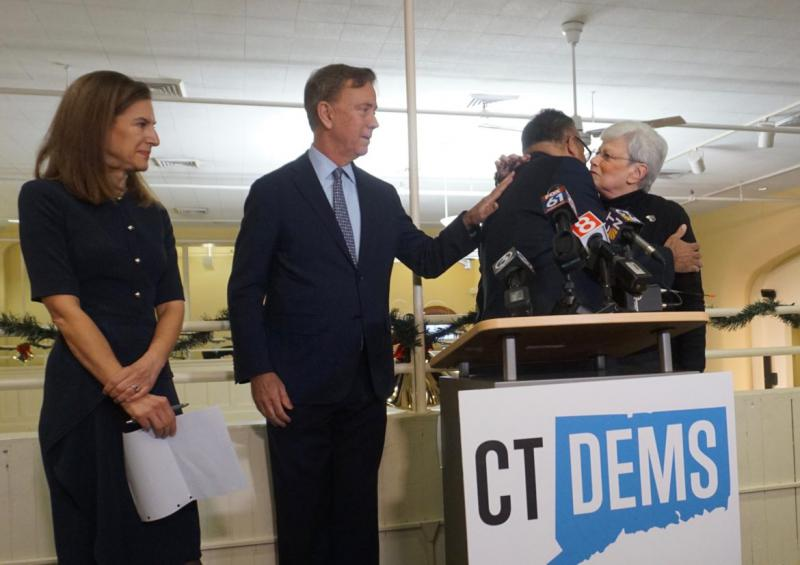 Susan Bysiewicz and Ned Lamont watch Nick Balletto embrace his successor, Nancy Wyman.