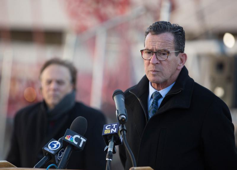 Governor Dannel Malloy speaks at a ceremony for a new parking garage built at the State Office Building in Hartford in December 2018.