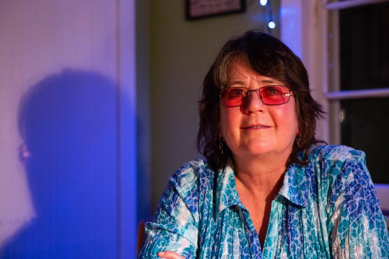 Lynn Mason sits at her kitchen table in October 2018. She says she still has nightmares about how her coworkers treated her after she reported an incident where a former elected official grabbed her.