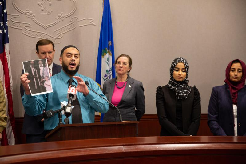 Fahd Syed, an advocate and Yemeni-American ally to U.S. Sen. Chris Murphy, shows a picture of a relative killed in the Yemeni Civil War. It was part of a plea for Americans at-large to push their legislators to withdraw military support to Saudi Arabia.