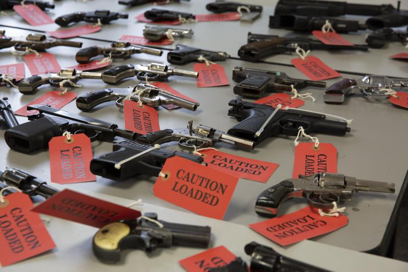 More than 80 handguns were turned in at the 10th Annual Capital Region Gun Buyback. Officers used the back of the tags to write down information about the guns, which aren't actually loaded.
