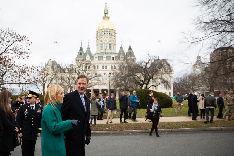 Governor Ned Lamont walks the Inauguration Day parade route Wednesday with his wife, Annie.