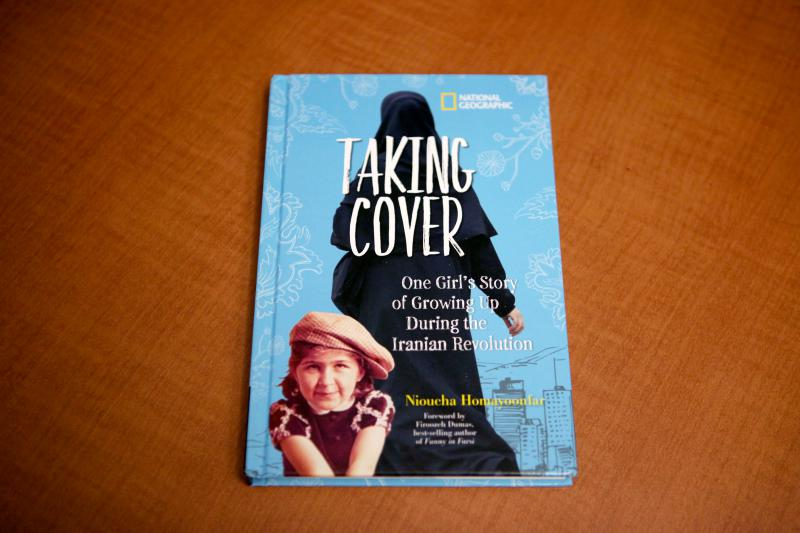 """""""Taking Cover: One Girl's Story of Growing Up During the Iranian Revolution"""" by Nioucha Homayoonfar."""