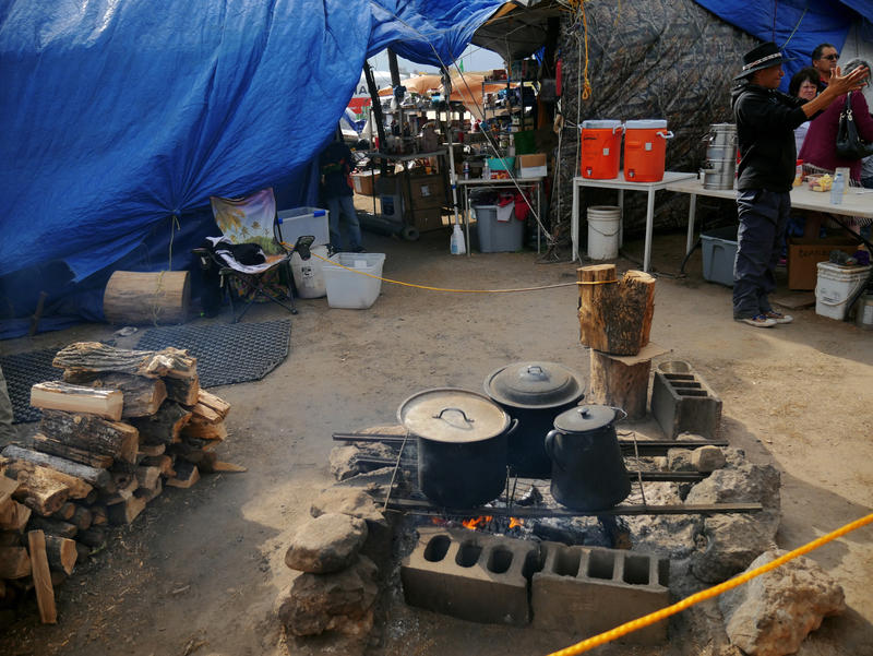 The main kitchen and sacred fire are situated on a low hill, right next to Oceti Sakowin's entrance. The spot serves as the primary gathering place. Most people come to this kitchen for breakfast and a late dinner.
