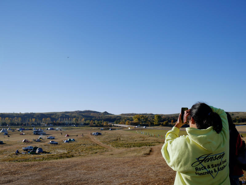 People pulled out their phones and filmed the helicopter making its daily rounds. Smartphones are almost always being used at Oceti Sakowin.