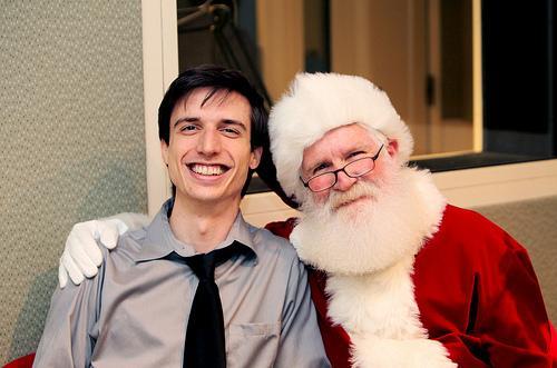 Patrick Skahill visits with Santa.