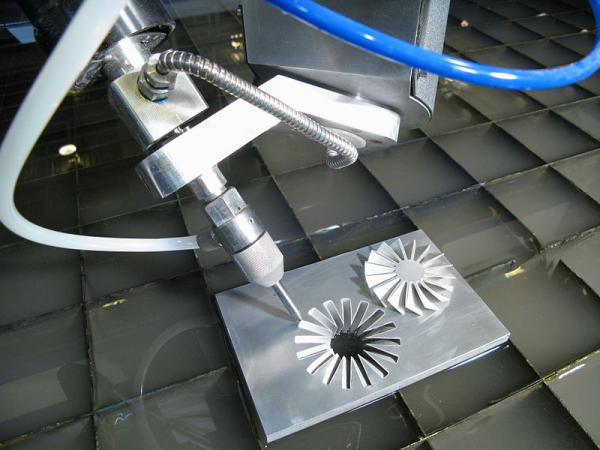 A five-axis waterjet cutting head can be used to cut intricate, three-dimensional parts on a CNC waterjet cutting machine -- the kind of technology that can be too expensive for small manufacturers.
