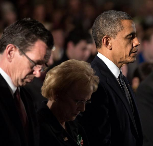 From left, Governor Dannel Malloy, Newtown First Selectman Pat Llodra, and President Barack Obama at a Sandy Hook interfaith vigil at Newtown High School on December 16, 2012.