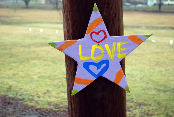 """This """"love star"""" Newtown memorial on a telephone pole appeared near the Newtown cemetery."""