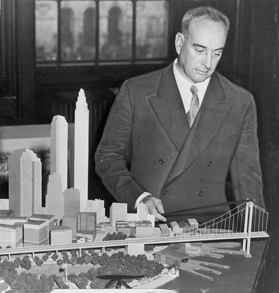 Robert Moses with a model of the Battery Bridge in New York City, which was built as a tunnel instead when the public opposed the potentially blocked view.