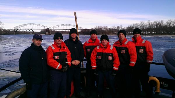 The crew aboard the deck of the USCGC Bollard. Aron Brewer, third from left, said the the ship was commissioned in 1967. He said his favorite part of the job was working with his crew. In the background is Middletown's Arrigoni Bridge.