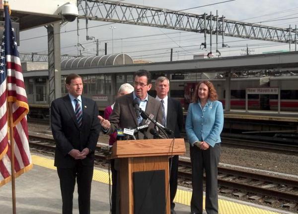 Governor Malloy announces upgrades to the New Haven line alongside other officials. Behind him, from left: Senator Richard Blumenthal, Lt. Gov. Nancy Wyman, DOT Commissioner James Redeker, and Rep. Elizabeth Esty.