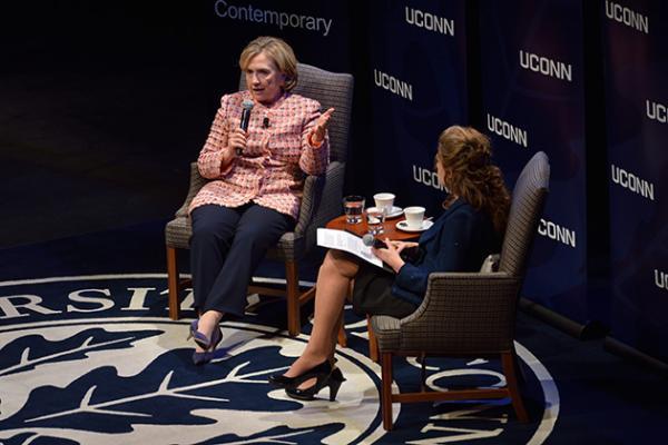 Hillary Clinton speaks to the crowd alongside UConn President Susan Herbst.